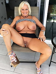 Amazing older slut is posing seminaked