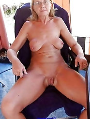 Brunette granny with amazing huge tits